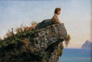 essenza donna guarda mare da scoglio